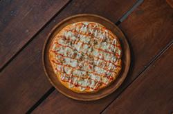 Ein Pizzateller aus Holz